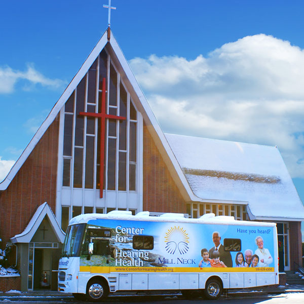 Center for Hearing Health Van in front of a Church